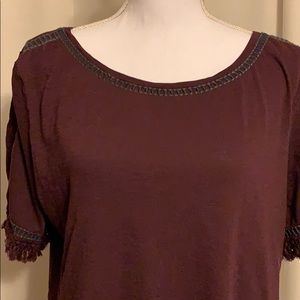 Maroon T-shirt with black stitching